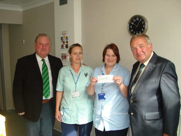 Richard and Peter present the cheque to staff at the pallative care unit.